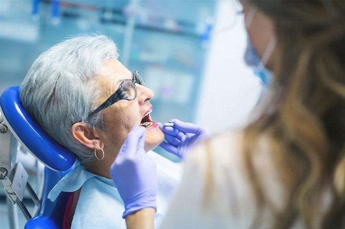 Woman who got mini-dental implants.